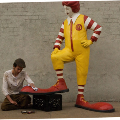 "Banksy's ""Shoe Shine Boy"" Jabs At Ronald McDonald"