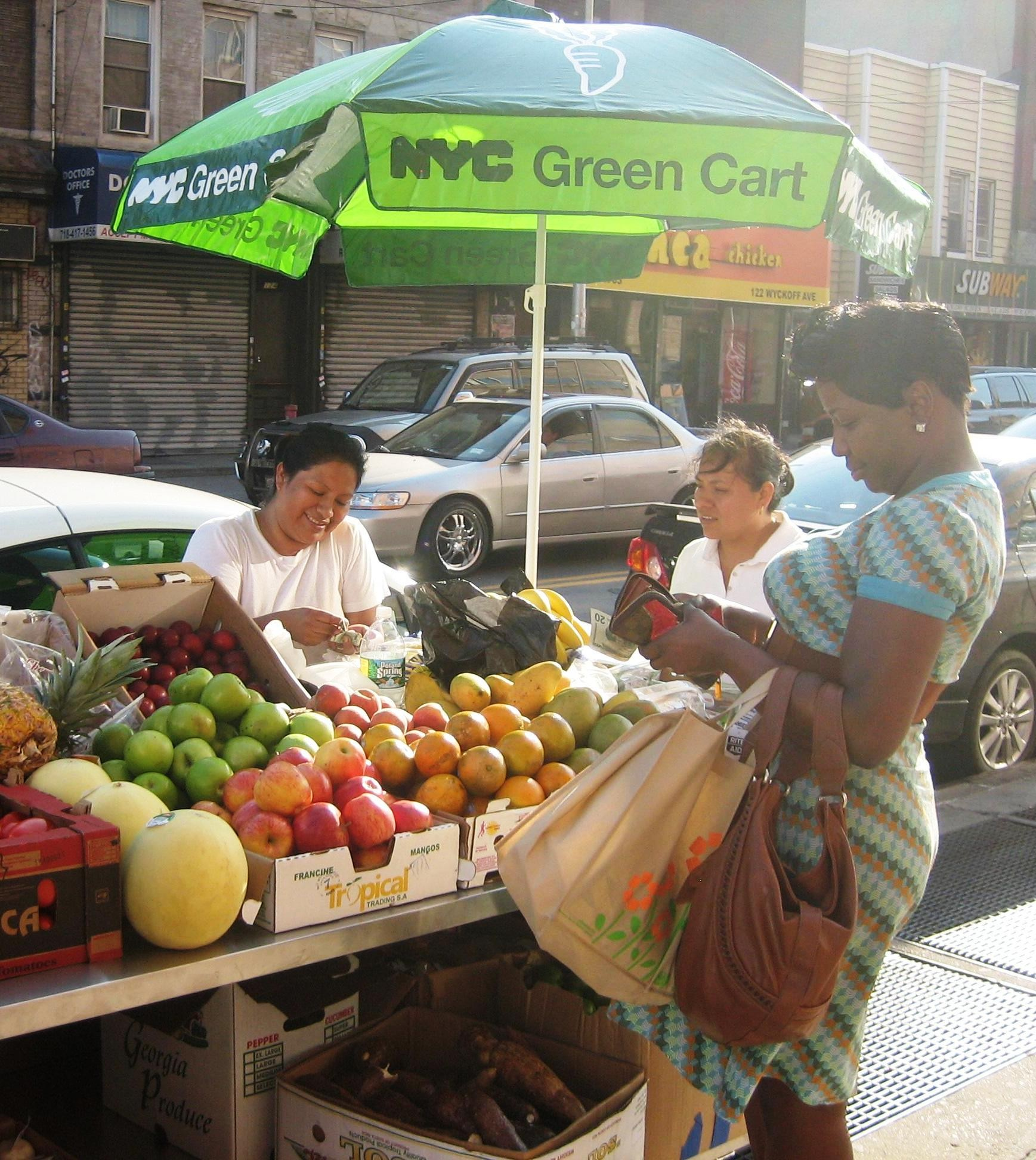 An NYC Green Cart on the street.