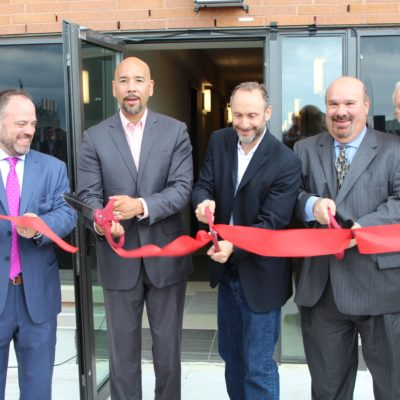 Ribbon Cutting At The 810 River Avenue Development