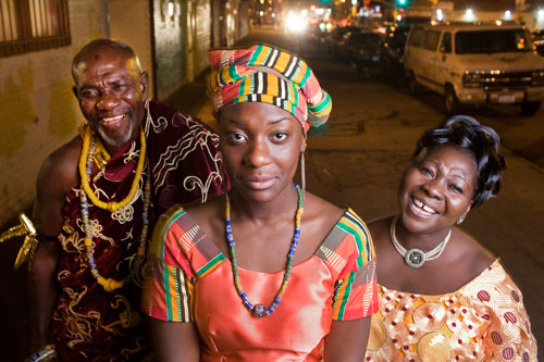 Rocky Otoo, 17, stands with her father, Nii Adjedu I, left, and her mother