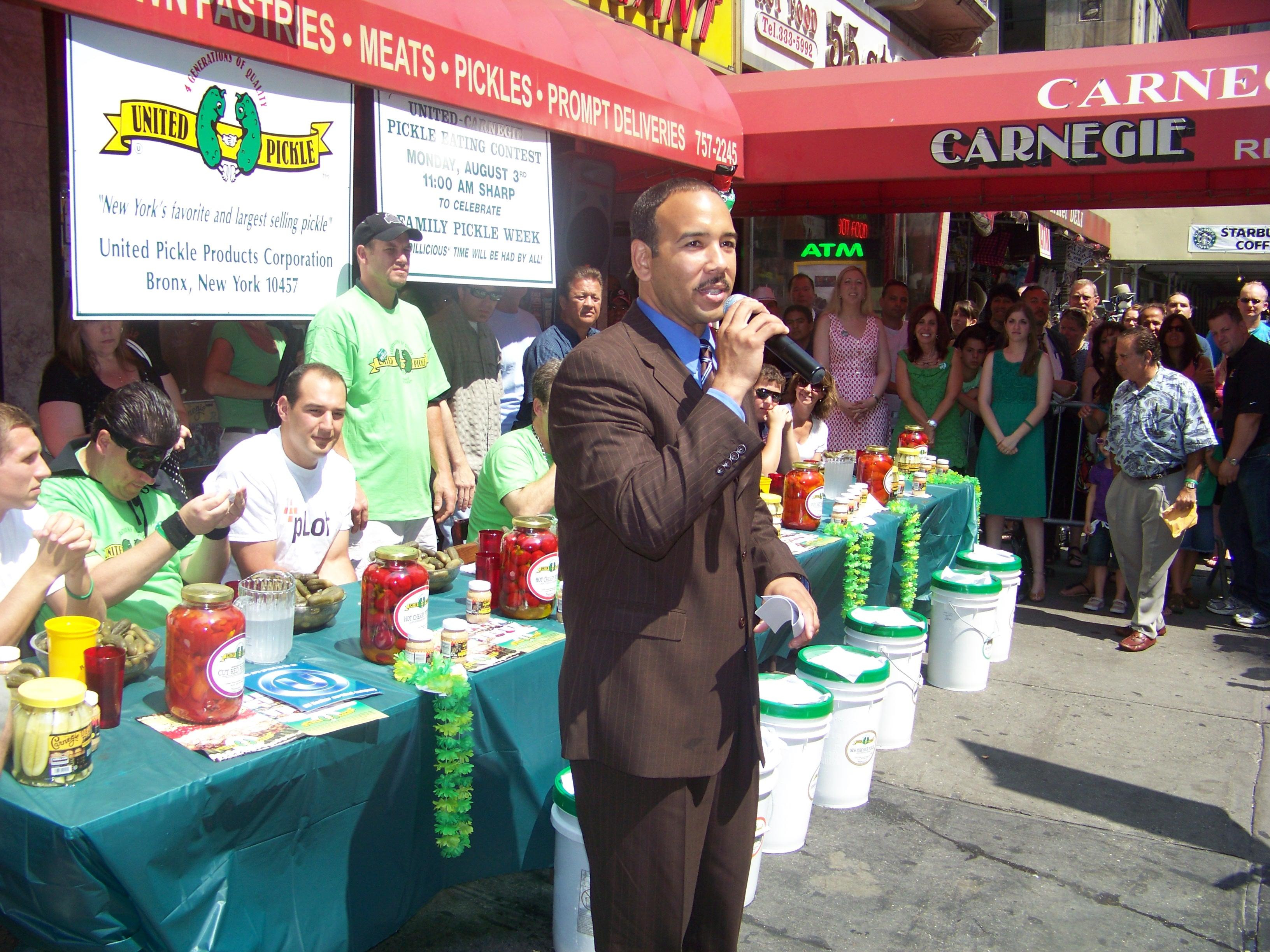 Bronx Borough President Diaz judges Pickle Eating Contest.