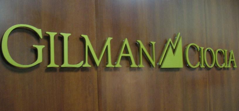 Gilman Ciocia, Inc. logo.
