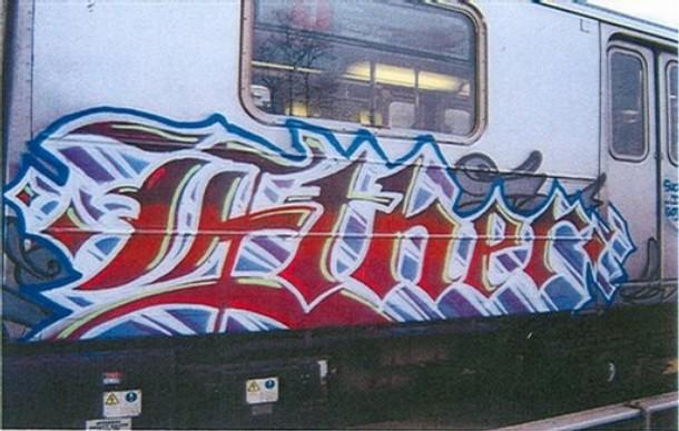 A NY subway car bearing the graffiti tag Ether.