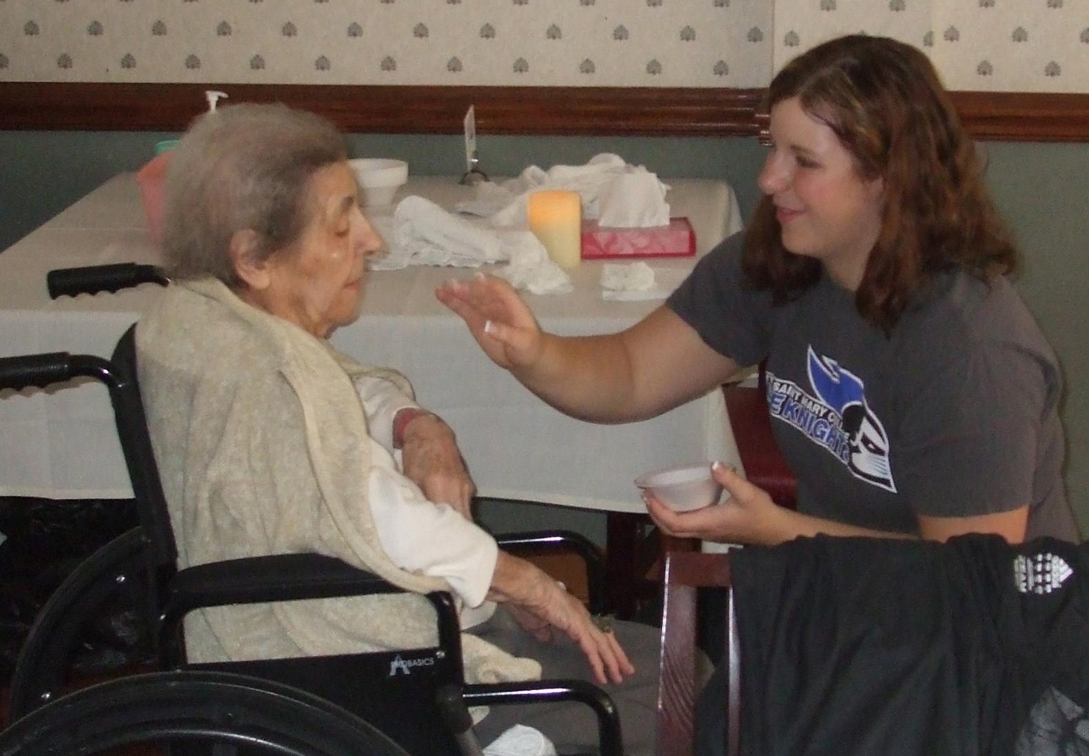 Jackie Ivan bonds with 102-year old Juliet Kruszenski.