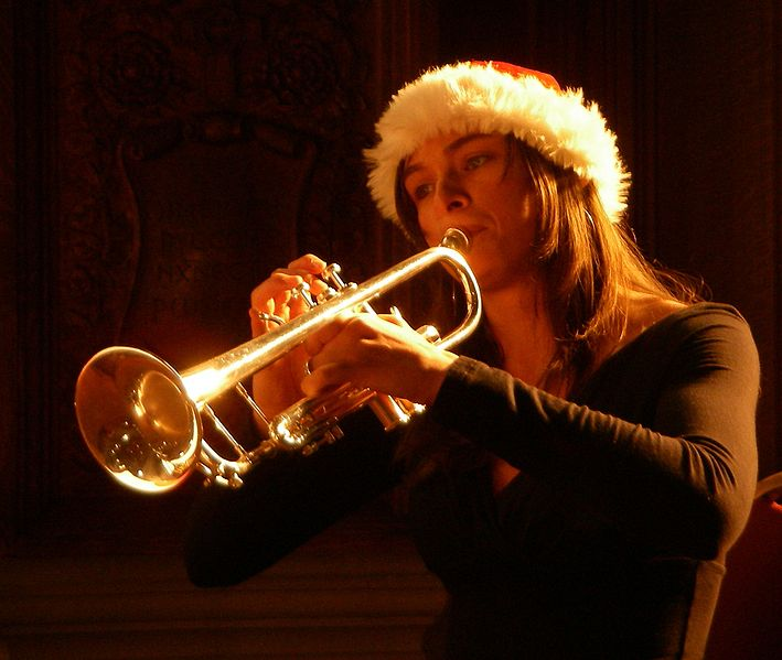 Trumpeter at a concert of Christmas music.